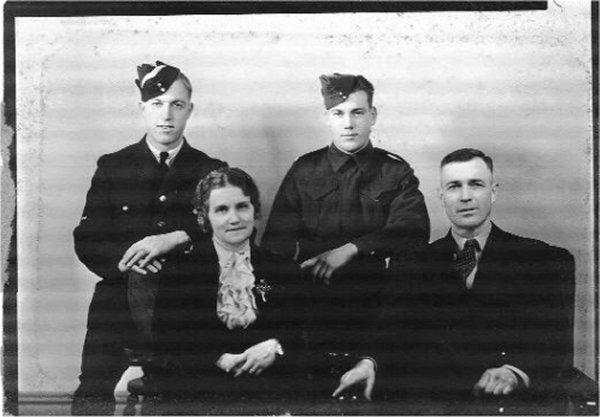 Photo of Edward Gray Thurston– Edward Gray Thurston on the Left Mack Albert Thurston on the Right sitting their parents Basil G. & Mary E.F. Thurston