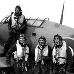 Group Photo– Four pilots of 438 Squadron in 1943: P/O R.E. Johnson on the wing and, from left to right, F/O R.F. Reid, F/O H.E. Dawber and F/O R.M. McKenzie. Johnson and McKenzie were killed in action on July 15th, 1944, and July 18th, 1944.