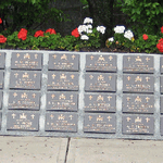 Memorial– A section of the Korea Veterans National Wall of Remembrance in Meadowvale Cemetery, Brampton, Ontario. The memorial consists of a central section and 13 other sections containing memorial plaques for each of the 516 Canadian service men who died while serving with the Canadian Forces in the United Nations operations in Korea. It was erected by the Korea Veterans Association of Canada and was dedicated on July 27, 1997.